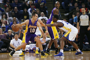 Los Angeles Lakers guard Steve Nash drives the ball during the first quarter of his NBA basketball game against Golden State Warriors in Oakland