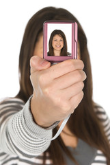 Teenager taking a self portrait