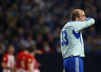 Schalke 04's Schober reacts after Athletic Bilbao's players celebrate a goal during their Europa League soccer match in Gelsenkirchen