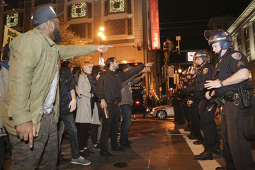 Protesters face off with police in front of the Westfield Mall during a demonstration against the grand jury's decision in the Ferguson shooting of Michael Brown, in San Francisco