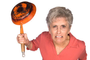 Angry woman with frying pan