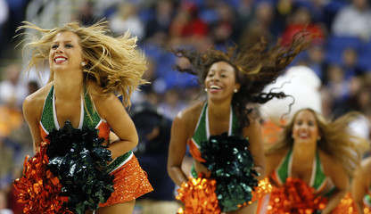 Hurricanes cheerleaders perform against the Eagles during the first half of their ACC Championship college basketball game in Greensboro