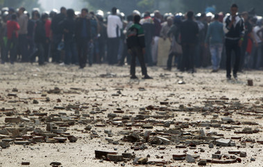 Stones thrown during clashes between army soldiers and protesters are seen at the cabinet near Tahrir Square in Cairo