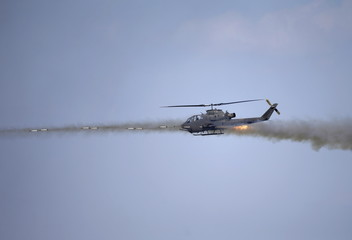 A South Korean army AH-1S helicopter participates in a U.S.-South Korea joint live-fire military exercise at a training field near the demilitarized zone separating the two Koreas in Pocheon