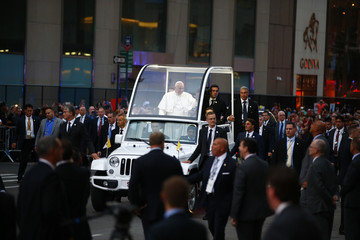 Pope Francis waves to crowds gathered to see him as he heads to St. Patrick's Cathedral for evening prayers in New York