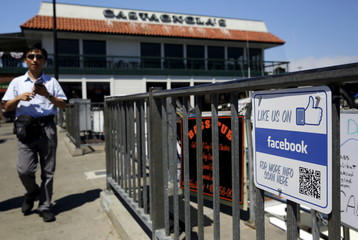 The Facebook logo is seen on a sign at the entrance to a fishing vessel at Fisherman's Wharf in San Francico