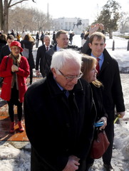 Sanders departs with his wife Jane Sanders after an interview with NBC News in Lafayette Square across from the White House in Washington