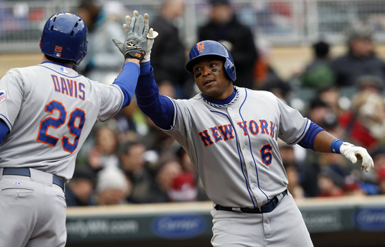 Mets' Byrd is congratulated at home by teammate Davis after he hits a solo homerun against Twins starting pitcher Diamond during the fifth inning of their Interleague MLB baseball game in Minneapolis