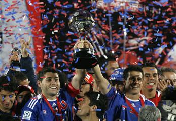 Players of Universidad de Chile celebrate after beating Ecuador's LDU in the Copa Sudamericana final soccer match in Santiago