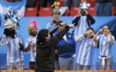 Argentina's coach Maradona gestures to crowd before start of their 2010 World Cup soccer match against Nigeria at Ellis Park stadium in Johannesburg
