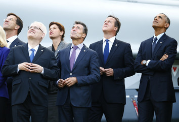 Government leaders watch a fly-past during the NATO summit at the Celtic Manor resort, near Newport