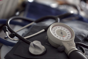 A photo illustration shows a stethoscope and  blood-pressure machine of a French general practitioner displayed in a doctor's office in Bordeaux