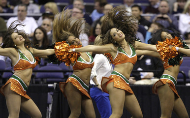 Miami Hurricanes cheerleaders perform in their East Regional NCAA men's basketball game against the Marquette Golden Eagles in Washington