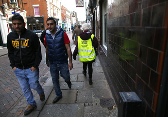 A UKIP activist wears a high visibility jacket while canvassing for votes for the by-election in Rochester
