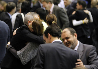 Delegates hug as they celebrate the accomplishment at the plenary session of the 10th Conference of the Parties to the COP10 in Nagoya