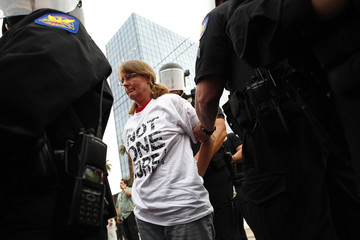 A demonstrator against the state's Senate Bill 1070 immigration law is arrested in Phoenix
