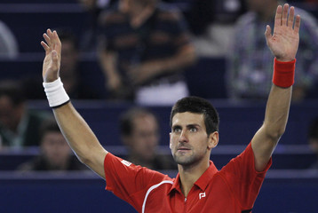 Djokovic of Serbia reacts after winning his men's singles semi-final tennis match against Berdych of the Czech Republic at the Shanghai Masters tennis tournament