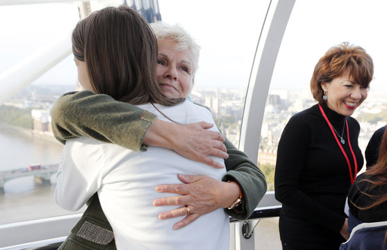 Actress Julie Walters hugs Dunraven School student Greta Tisza during a mentoring session held in the London Eye to mark the third UN International Day of the Girl in central London