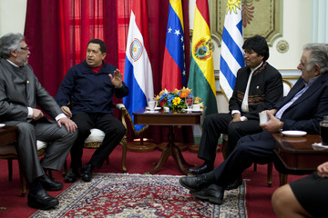 Venezuela's President Hugo Chavez talk to other leaders during a meeting at Miraflores Palace in Caracas