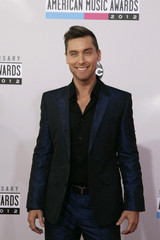 Pop star Lance Bass arrives at the 40th American Music Awards in Los Angeles