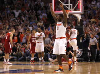Syracuse Orange's Dion Waiters celebrates after the Orange defeated the Wisconsin Badgers in their men's NCAA East Regional basketball game in Boston