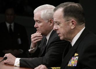 Secretary of Defense Gates and Admiral Mike Mullen conduct a news briefing