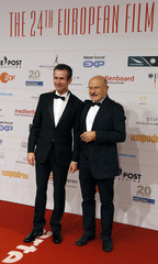 Director Schloendorf and actor Matthes arrive on red carpet for the 24th European Film Awards ceremony in Berlin