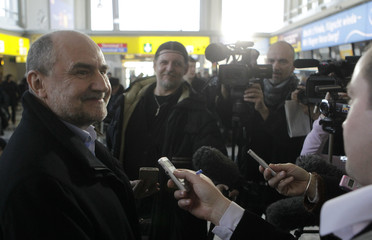 Nackaerts of the IAEA talks to journalists at the airport in Vienna