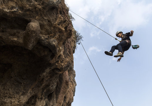 Rock climber Nazia Parveen descends during training in Islamabad