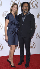 Director Alejandro Gonzalez Inarritu and his wife Maria Eladia attend the Producers Guild Awards in Los Angeles
