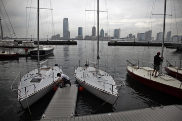 People secure their boats before the arrival of Hurricane Irene at downtown Manhattan in New York