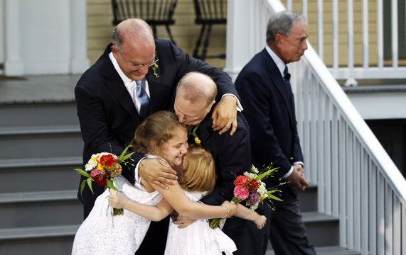 New York City Mayor Bloomberg walks away after presiding over the wedding of Mintz , the city's consumer affairs commissioner, and Feinblatt, a chief adviser to the mayor, in New York