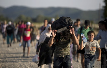 A group of migrants make their way after crossing the Macedonian-Greek border near Gevgelija