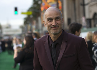 """Director of the movie Gillespie poses at the premiere of """"Million Dollar Arm"""" at El Capitan theatre in Hollywood"""