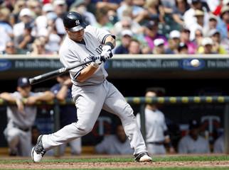 New York Yankees Russell Martin hits a sacrifice fly off Minnesota Twins pitcher Phil Dumatrait in Minneapolis