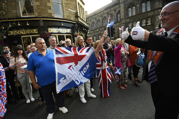 A member of the Orange Order gestures to the crowd during a pro-Union rally in Edinburgh, Scotland