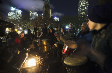 """People play drums during the """"Occupy Toronto"""" movement at St. James park in Toronto"""