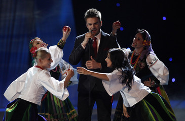 """Marcin Mrozinski from Poland performs his song """"Legenda"""" during semi-final one of the Eurovision Song Contest in Oslo"""
