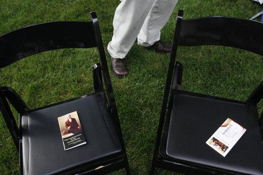 Cedar Falls Tea Party leader Saul places copies of the Constitution ahead of hosting Republican presidential hopeful Santorum in Cedar Falls, Iowa