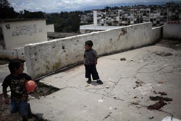 Children play at the La Verbena cemetery in Guatemala City
