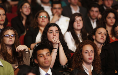 Students listen to U.S. President Obama talk at the Jerusalem Convention Center in Jerusalem