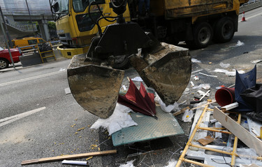 A crane removes an umbrella at the main protest site in Admiralty in Hong Kong