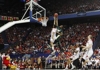 University of Louisville's Blackshear blocks the shot of Colorado State's Octeus during their third round NCAA basketball game in Lexington