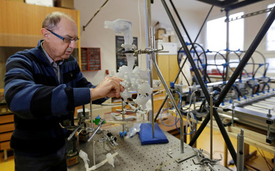 Scientist Miroslav Jicha sets up a model of a functioning human lung in Brno