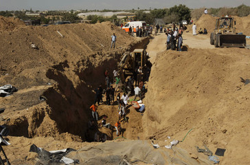 People search for bodies of Palestinians killed in Israeli air strikes in Rafah in the southern Gaza Strip