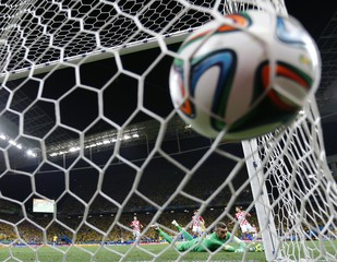 Croatia's goalkeeper Stipe Pletikosa lies on the ground after Brazil's Oscar scored a goal during their 2014 World Cup opening match at the Corinthians arena in Sao Paulo