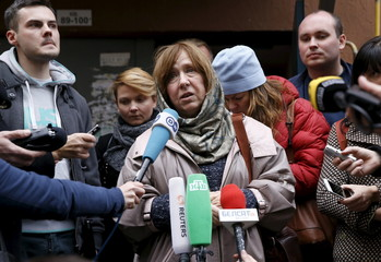 Belarussian author Alexievich answers questions from journalists after a news conference in Minsk