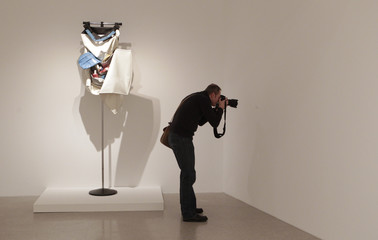 Photographer takes picture of a description to an art installation by Swedish-born artist Oldenburg during exhibition at momak in Vienna