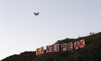 "A temporary draping of the Hollywood sign that reads ""Save the Peak"" is seen in Los Angeles"
