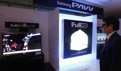 A man watches a 3D TV using light emitting diode-backlit LCD display in Seoul